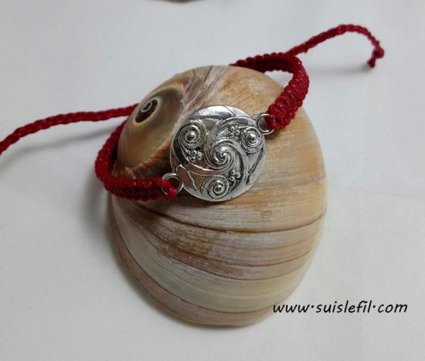 red triskele bracelet